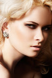 Luxury and fashion style. Female face with make-up Royalty Free Stock Photos