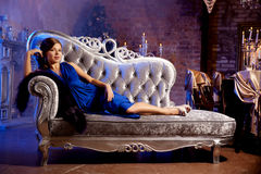 Luxury fashion stylish woman in the rich interior. Beauty girl w Stock Images