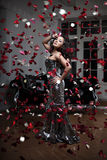 Luxury fashion woman. With rose petals Royalty Free Stock Photography