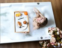 Luxury fashion woman in the morning take breakfast in hotel spa lying Royalty Free Stock Photo
