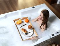 Luxury fashion woman in the morning take breakfast in hotel spa lying Stock Images