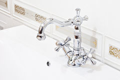 Luxury faucet. And tiles on white sink Stock Photo