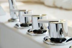 Luxury faucet. In the bathroom Stock Photos