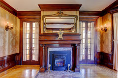 Luxury fireplace with mirror and antique clock Royalty Free Stock Photo