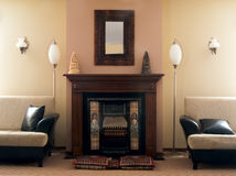 Luxury fireplace room. With sofa and lamp Royalty Free Stock Photography
