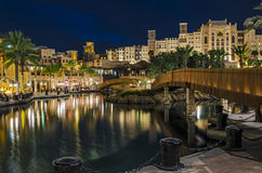 Luxury five-star hotel in night illumination. Night view of the artificial canal, Souk Madinat Jumeirah on the Arabian Gulf. Dubai, United Arab Emirates Royalty Free Stock Photo