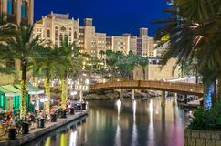 Luxury five-star hotel at night. Night view of the artificial canal, Souk Madinat Jumeirah on the Arabian Gulf. Dubai, United Arab Emirates stock photos