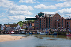 Luxury flats in converted granary Wells Next The Sea, Norfolk. The seafront granary that was converted into luxury flats on the seafront at Wells Next The Sea Stock Image