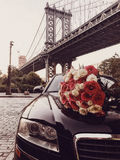 Luxury flower bouquet and limousine car service for romantic date in the city stock photo