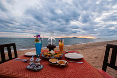 Luxury food set on the beach Stock Images