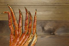 Crab claw on wooden background royalty free stock photo