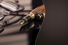 Luxury fountain pen and glasses with space for text Royalty Free Stock Images