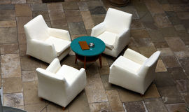 Luxury four white chairs. From hotel courtyard Stock Images