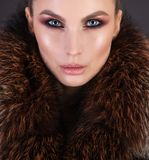 Luxury fur and beautiful girl with strong makeup Stock Photography
