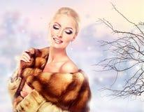 Luxury Fur Coat. Winter Woman in Luxury Fur Coat. Beauty Fashion Model Girl Stock Images