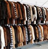 Luxury fur coats hanging on rack Stock Photography