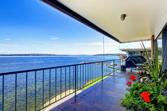 Luxury furnished covered deck with grill, and view of Lake Washi Stock Photo
