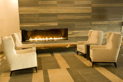 Hotel lobby living room. Luxury furniture at a hotel lobby living room with modern fireplace Stock Photography