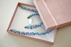 Luxury gift. A luxury gift box with a blue handmade necklace Royalty Free Stock Photography