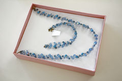 Luxury gift. A luxury gift box with a blue handmade necklace royalty free stock photos