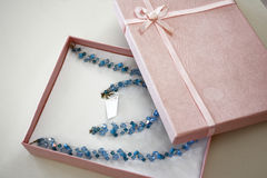Luxury gift. A luxury gift box with a blue handmade necklace Royalty Free Stock Images