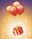 Luxury gift hanging on red balloons with magic lights. For Birthday, Christmas,New year's eve ,Valentine Stock Photography