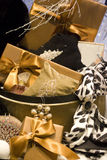 Luxury gifts. Some luxury gift packing with ribbons on them and some ornaments nearby Stock Photo
