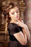 Luxury girl, amid the vintage interior Royalty Free Stock Photos