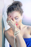 Luxury girl and pearls Stock Image