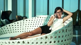 Luxury girl using phone in high business interior stock footage