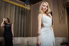 Luxury girls in evening dresses in beautiful Stock Image