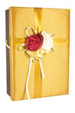Luxury give box. Luxury gold give box on white Stock Images
