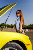 Luxury glamour girl and yellow sport car Royalty Free Stock Photography