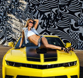 Luxury glamour girl and yellow sport car Stock Photography