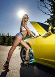 Luxury glamour girl and yellow sport car Stock Photos