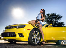 Luxury glamour girl and yellow sport car Royalty Free Stock Images