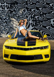 Luxury glamour girl and yellow sport car Stock Image