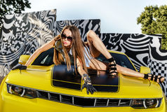Luxury glamour girl and yellow sport car Stock Images