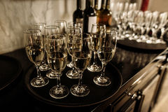 Luxury glasses with golden champagne on stylish decorated table stock images