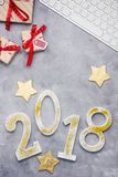 Luxury glitter numbers 2018 with keyboard and presents on grey concrete background. New year concept. Text space Stock Image