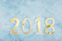 Luxury glowing numbers 2018 made from gold shiny glitter on blue background. New year concept. Text space Royalty Free Stock Images