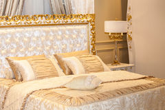 Luxury gold bedroom Stock Photos
