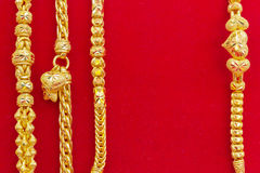 Luxury gold bracelets on red flannel. Royalty Free Stock Image