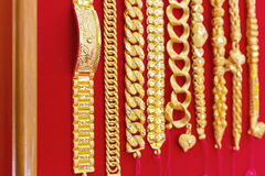 Luxury gold bracelets on red flannel. Royalty Free Stock Photos