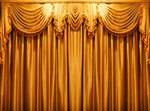 Luxury gold fabric curtains backdrop on the theate Royalty Free Stock Photography