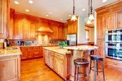 Luxury gold kitchen room Royalty Free Stock Photo