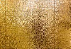 Luxury gold mosaic tiles background for bathroom or toilette tex. Ture. Golden shiny ceramic tile wall pattern. High resolution photo royalty free stock photos