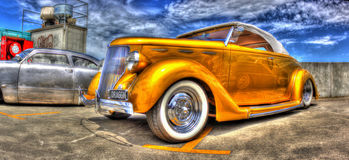 Luxury gold painted 1936 Ford convertible Stock Photos