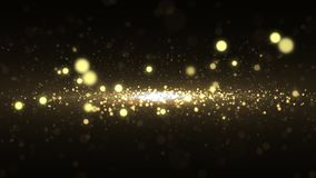 Luxury gold particle glitter abstract background for happy new year and merry christmas festive season middle light ray stock video