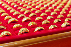 Luxury gold rings on red flannel. Royalty Free Stock Photo